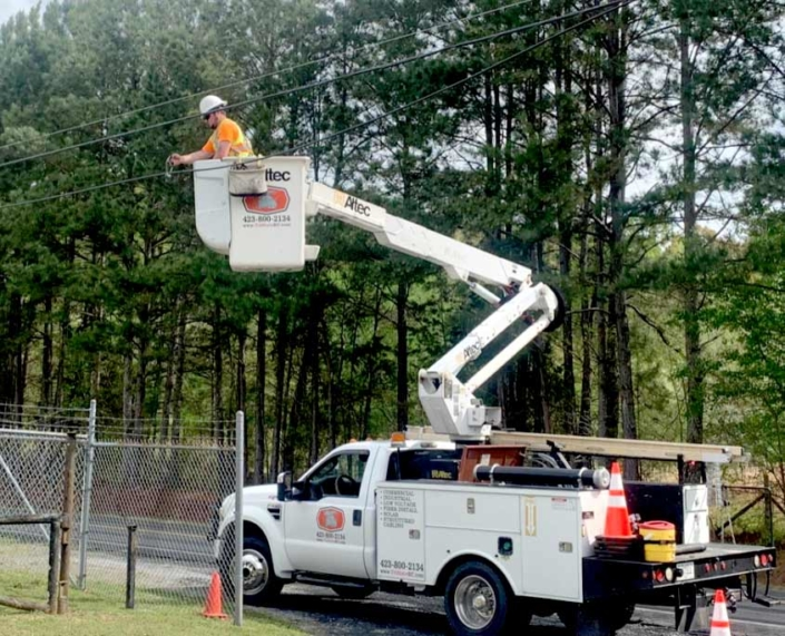 Bucket truck worker wiring for solar energy services in Chattanooga