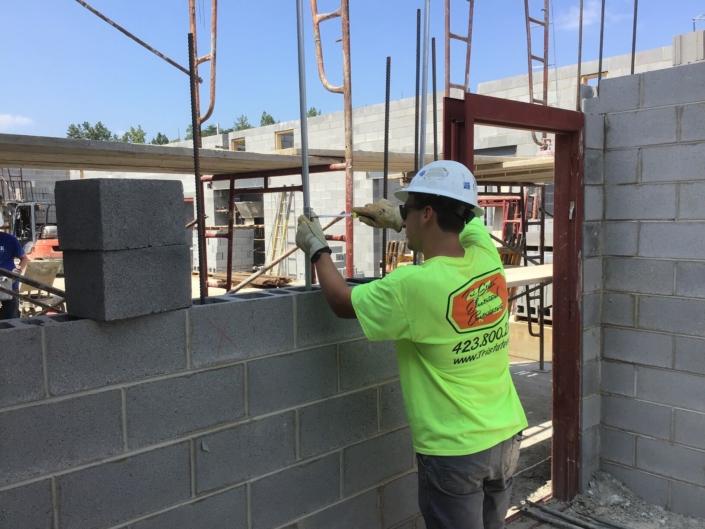 Worker wiring new solar energy installation in Nashville