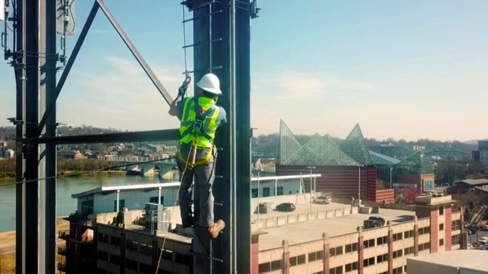 Climbing worker from commercial electrical company in Nashville