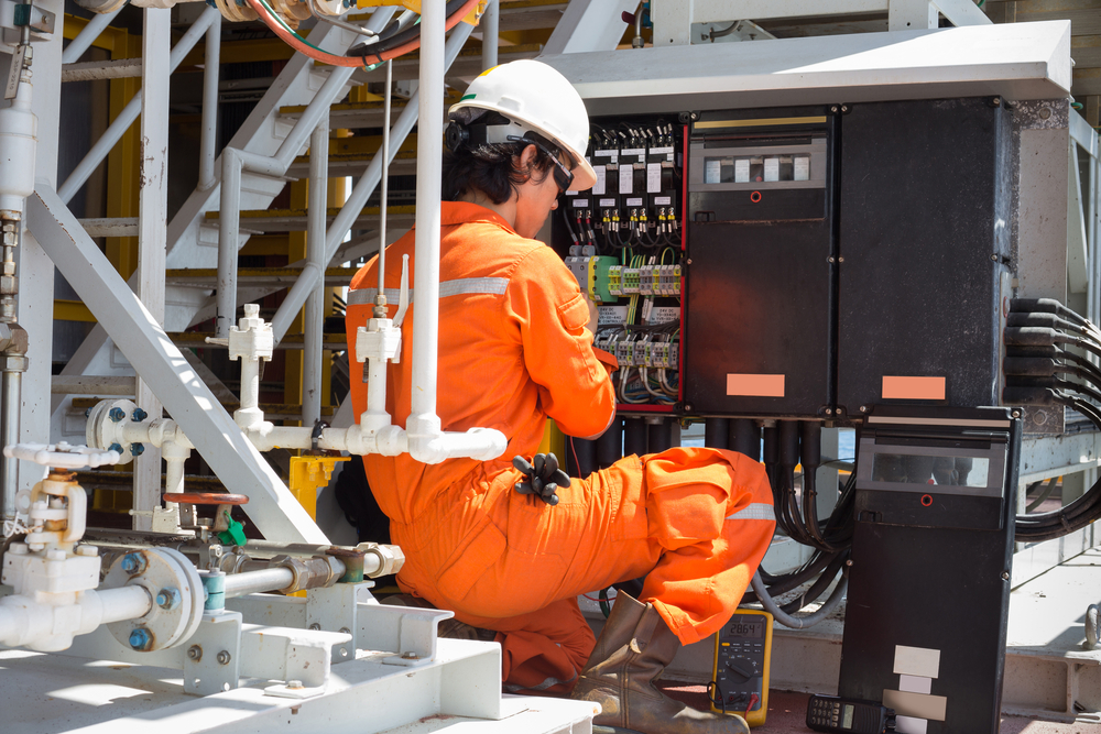 Worker installing a high-voltage industrial electrical project