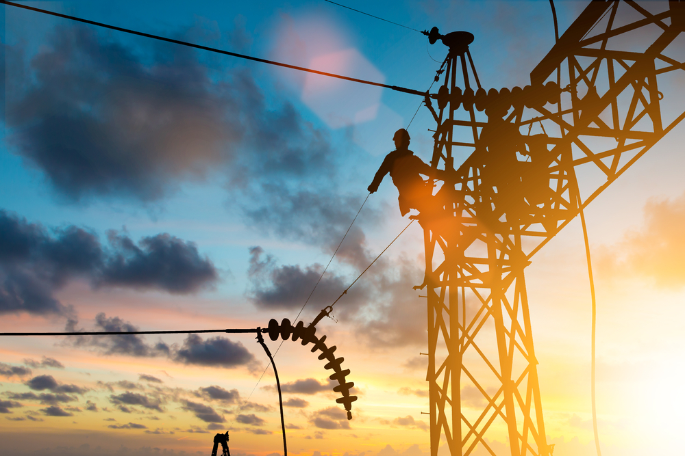 Industrial electrician at an electrical substation installation